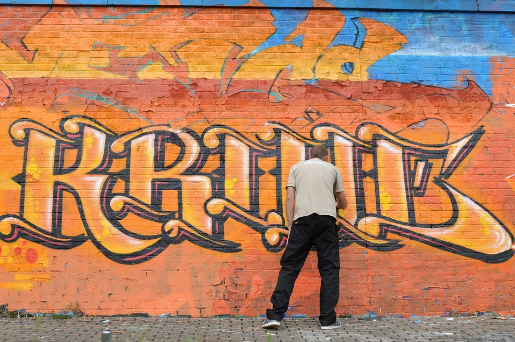 One of the graffiti artists at work