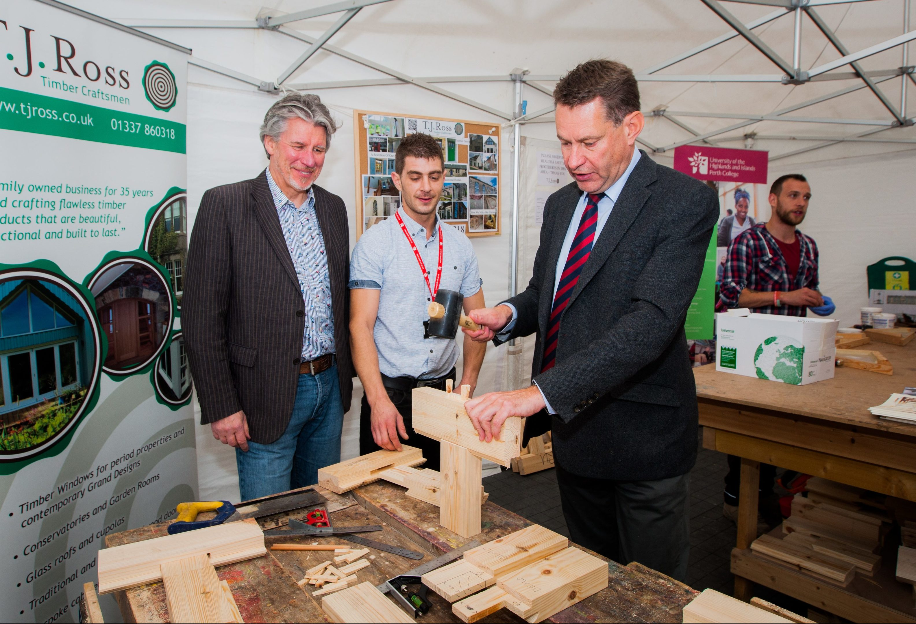 Picture shows left to right, Martin Richardson (owner of TJ Ross Joiners, John Daly (lecturer Perth College UHI (joinery) and Murdo Fraser MSP trying his hand at joinery.