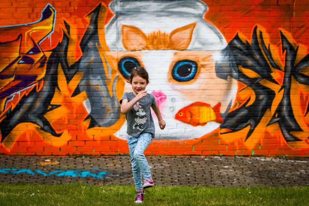 Evie McLaren (aged 5 from Dundee) with her Dad's work in the background