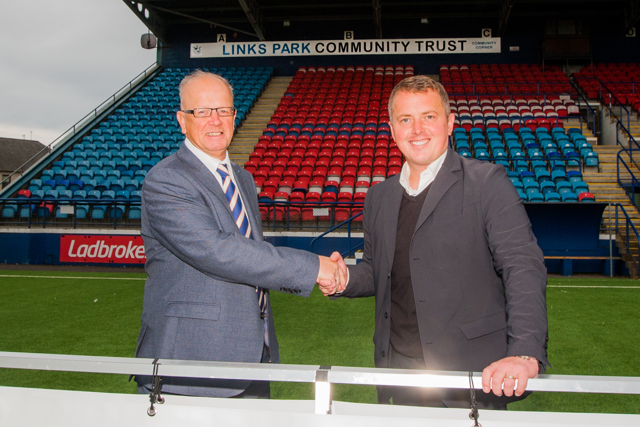 Picture shows club chairman John Crawford (left) and Peter Davidson (LPCT Chief Executive, right).
