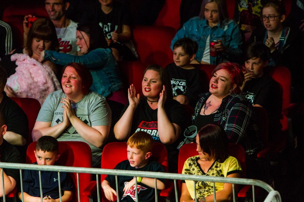 Fans at the wrestling event.
