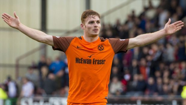 Fraser Fyvie celebrates after his superb strike made it 3-0.