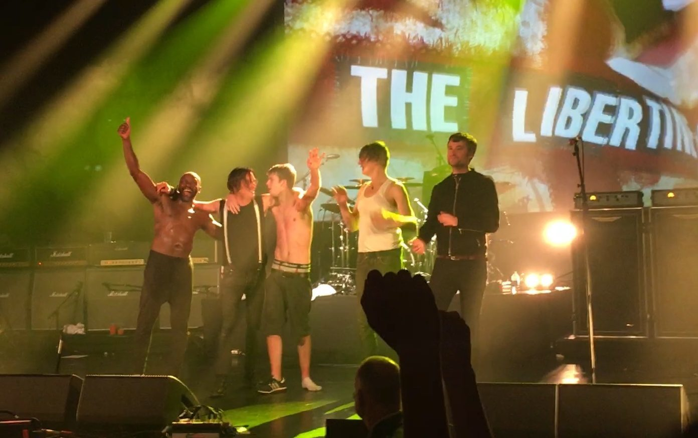 Libertines fan is welcomed on stage by the band in Dunfermline.