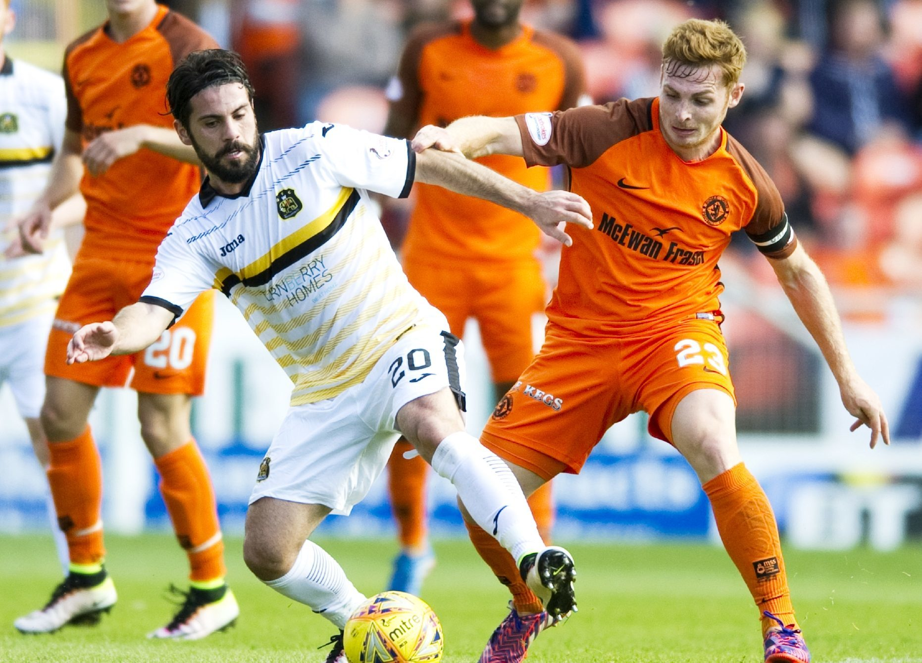 Dimitris Froxylias and Fraser Fyvie battle for possession.