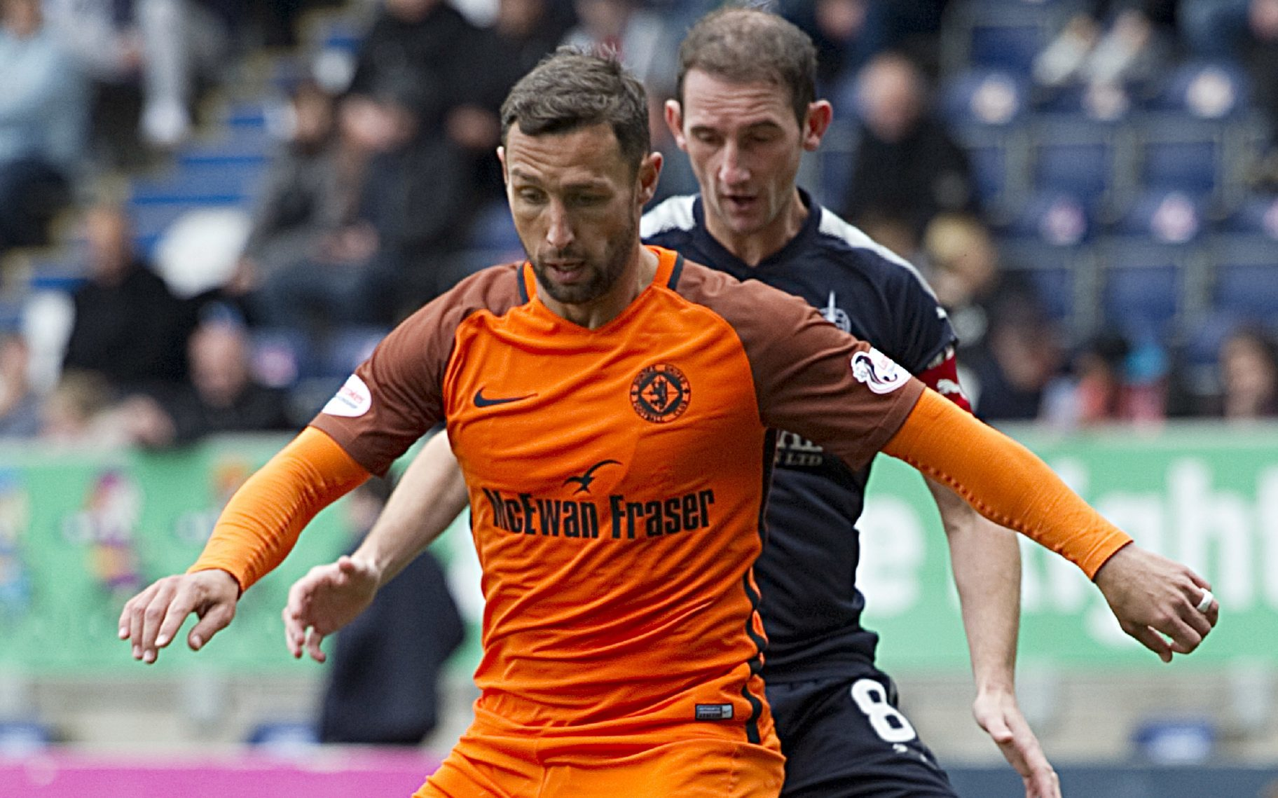 Scott McDonald of United holds off Falkirk player Mark Kerr.