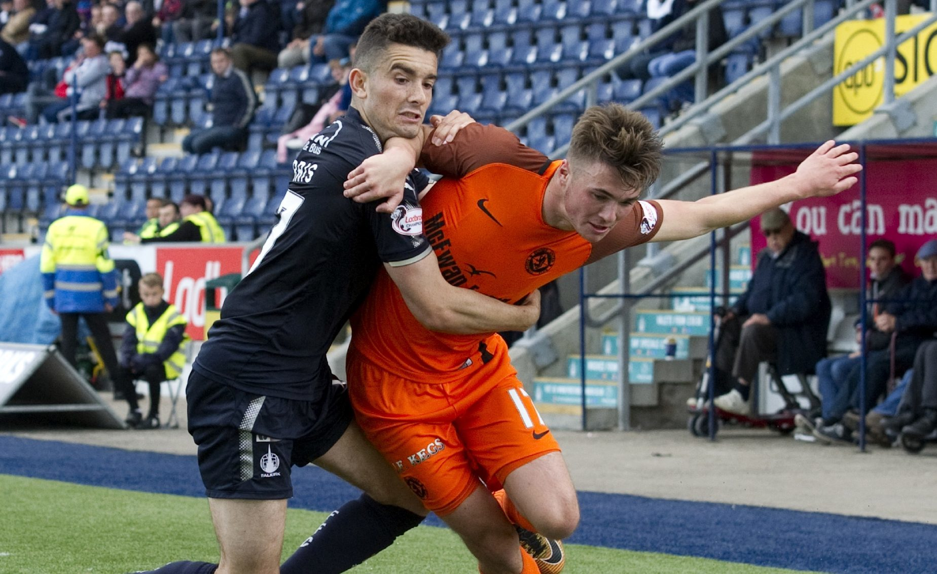 Jamie Robson of United battles with Falkirk's Alex Harris.