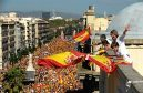 People wave Spanish flags in a protest in Barcelona against Catalan independence moves.