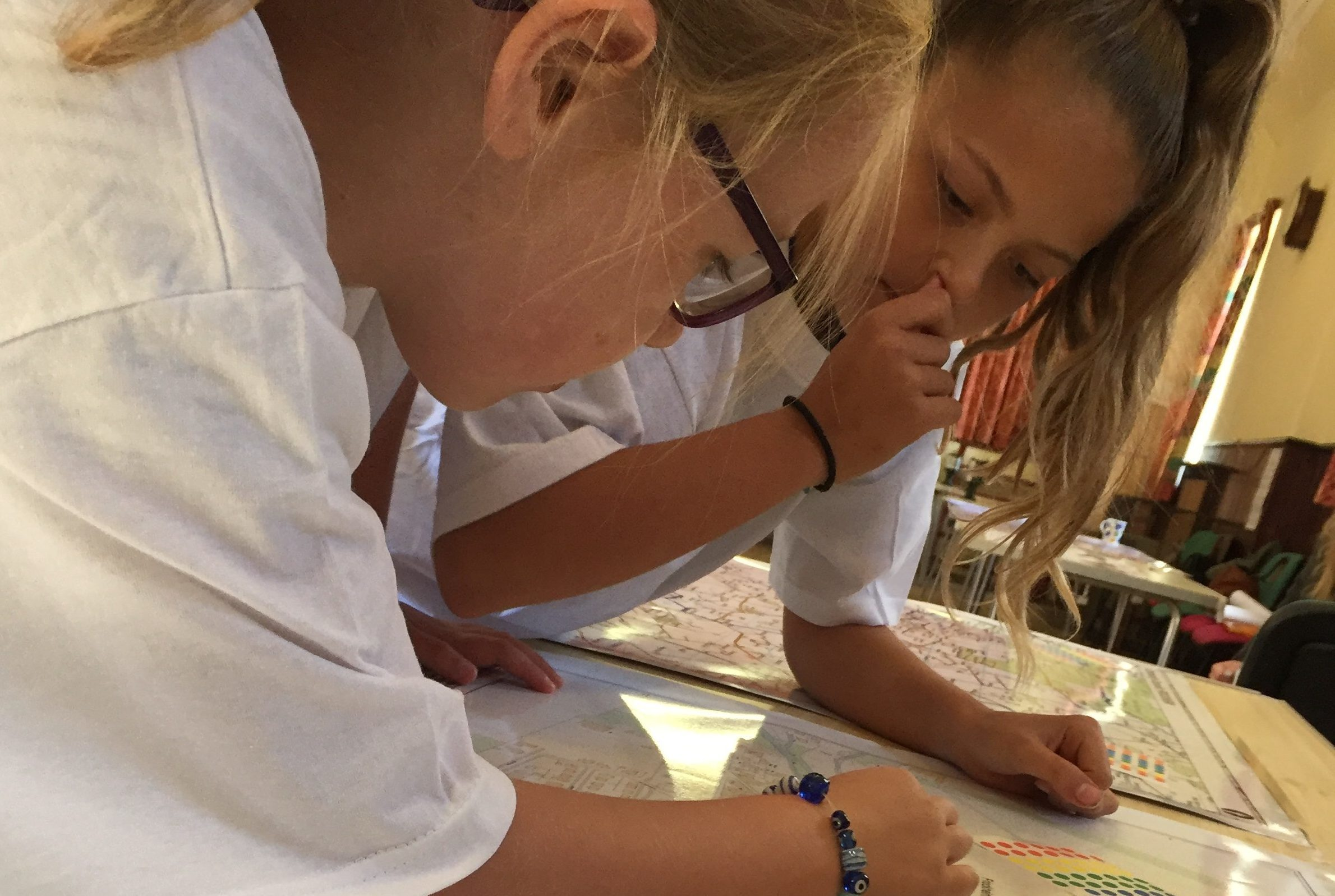 School children Kirstin Neate and Kristie Wilson pore over the plans at the event.