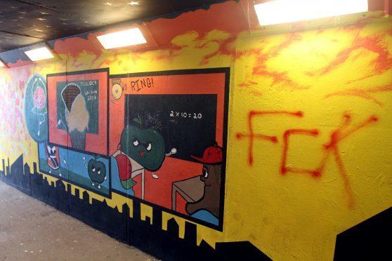Vandals spray paint kids\' public art project in Perth underpass ...