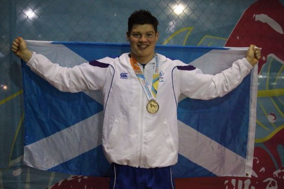 Scott McLay with one of his Commonwealth Youth Games golds.