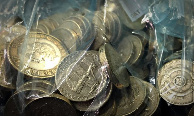 Bags of the old £1 coins.