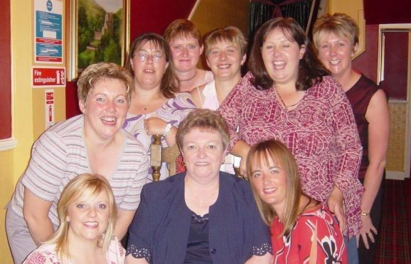 Mags Black (centre) at a reunion event with some of the girls from the Sea Cadet unit