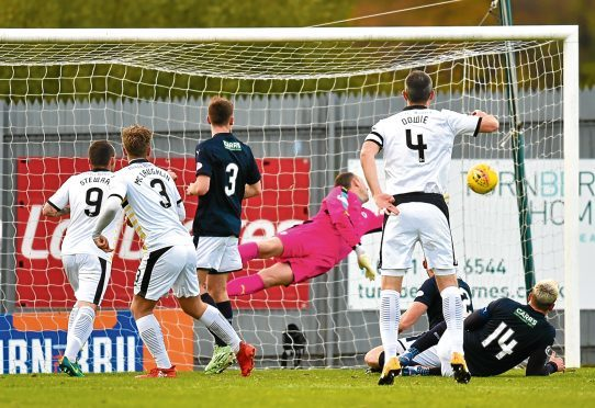 Dumbarton's Christopher McLaughlin scores to make it 1-0.