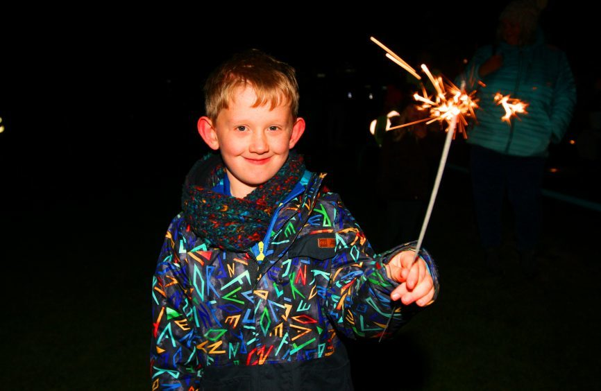 7 year old Ollie Holt enjoying the night