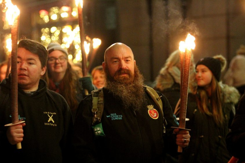 The torch-lit procession through Dundee ahead of the switch-on event.