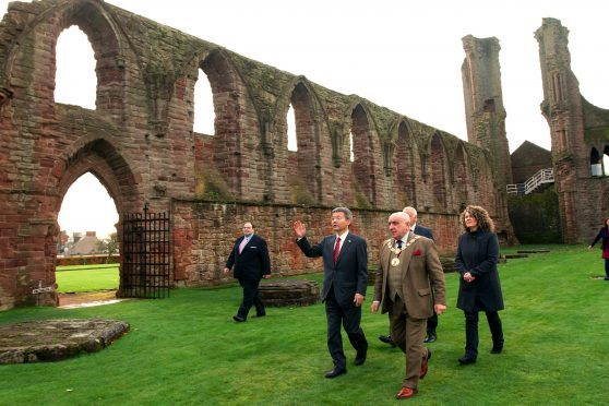 Courier Arbroath News- Japanese Consul General Daisuke Matsunaga visits Arbroath Abbey,picture shows; with Provost Proctor & steward Andrew Kennedy,dressed as a Benedictine Monk, who was showing them around,tuesday 14th november.