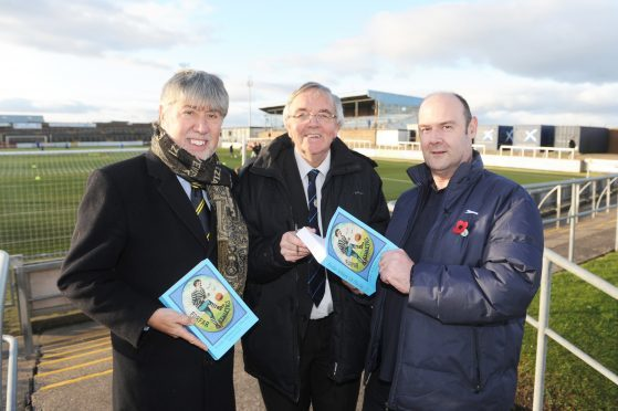 Author David Potter (centre) with fans Richard Grant and Alan Pirie at Station Park