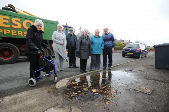 Nesbitt Street residents have signed a petition to get the council to pave one side of the road that has been in a state of disrepair for more than 20 years.