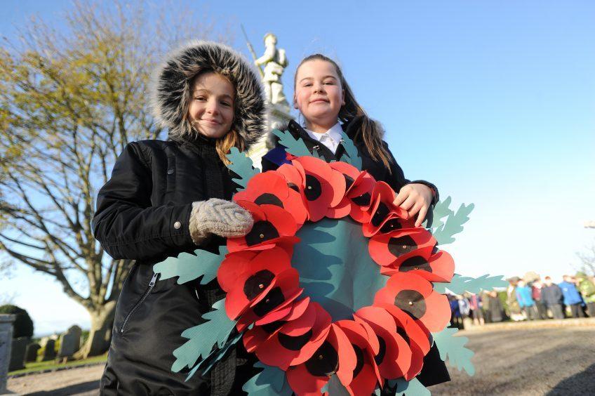 KIRRIEMUIR: Northmuir P7 pupils Rachael Shaw (11) and Sasha Cameron (11) with the wreath they were to lay at Kirriemuir War Memorial.