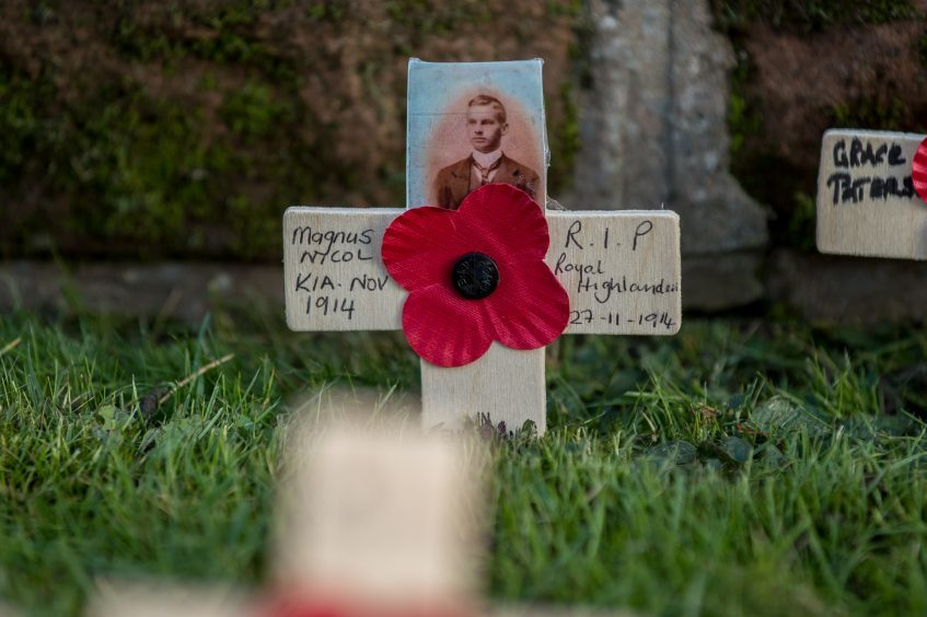 A cross in the remembrance garden for a soldier who fell in the first months of the Great War.
