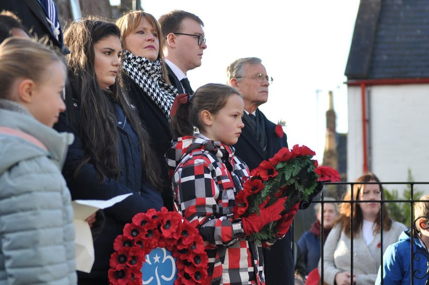 Children lead the Johnshaven Community Remembrance event.