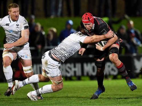 Edinburgh's Grant Gilchrist makes a powerful carry against Ospreys at Myreside.