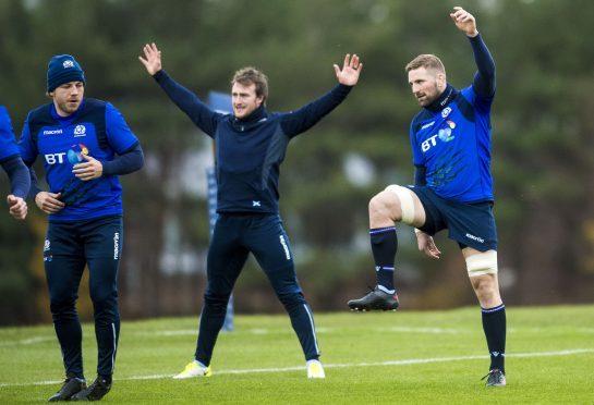 Scotland captain John Barclay (r) in training with Hamish Watson (l) and Stuart Hogg (c).