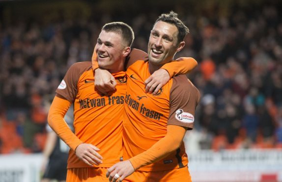 Scorer Jamie Robson is congratulated by Scott McDonald after United's second