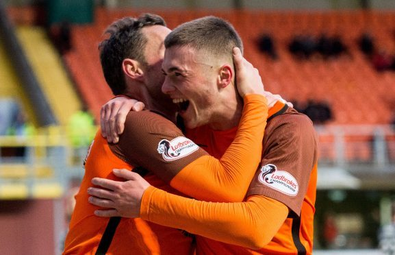Jamie Robson is congratulated by Scott McDonald after his goal.