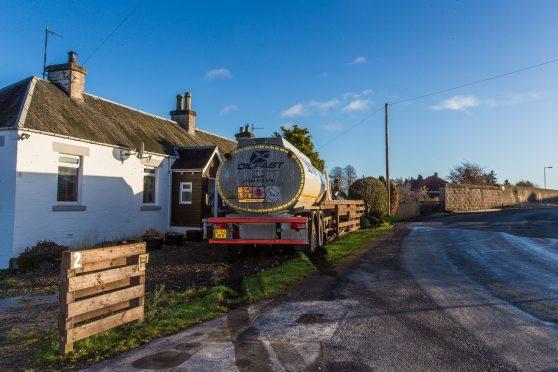 The tanker in the garden of a house after sliding on icy roads.