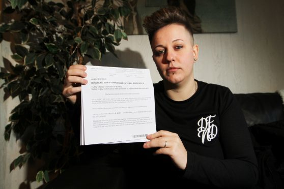 Kellie Livingston, 30  with the speeding ticket she received (Pics by Mhairi Edwards)
