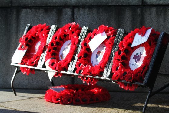 Wreaths lain at the top of the Law Hill by the War Memorial.