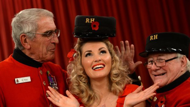 Amy Hawthorn  tried on a Chelsea Pensioners Cap supplied by Staff Sergeant Bill Bullick ,70, and Col Sergeant John Nicoll, 74, ex Black watch at Dundee.