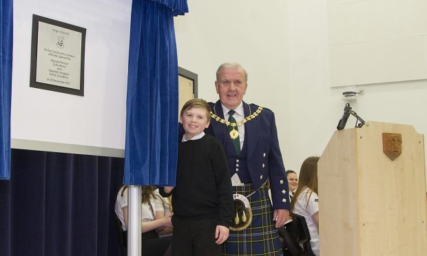 Deputy provost Colin Brown unveiling a plaque with first year pupil Stephen Langdon.