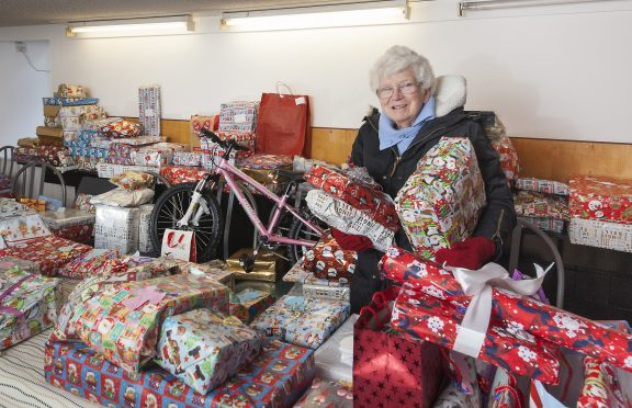 Irene Gillies with the presents that have been donated.