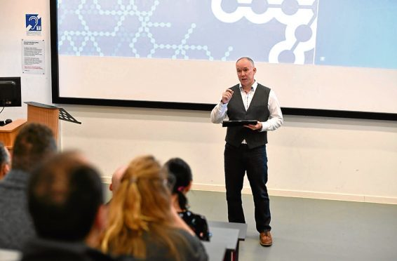 Dundee Accelerator manager Andy Campbell addresses the business showcase event at Dundee University.