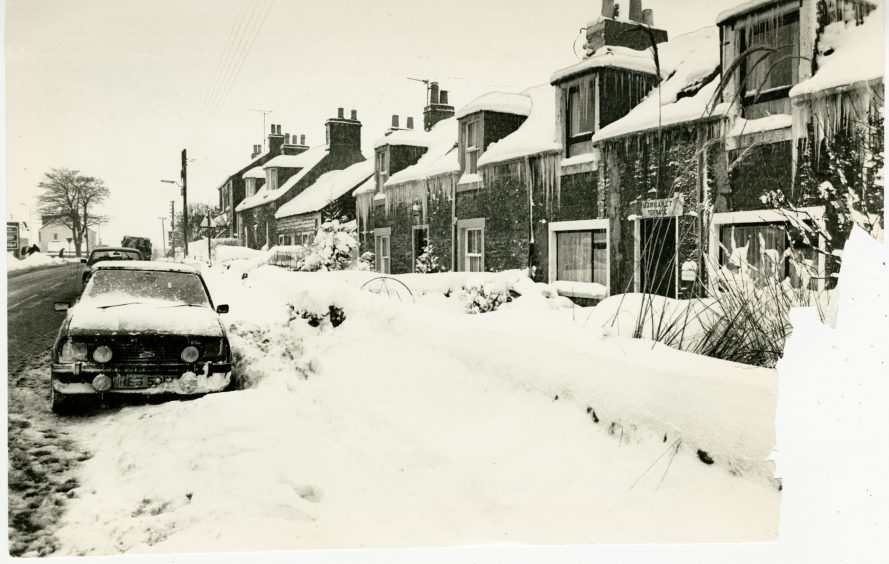 Photograph showing the large quantities of snow beside housing at Muirhead after a snow storm in the Dundee area. January 14, 1987.
