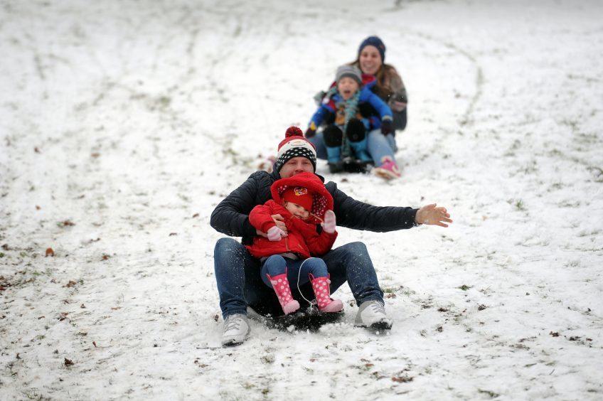 The Buchan family were out enjoying some sledging fun.
