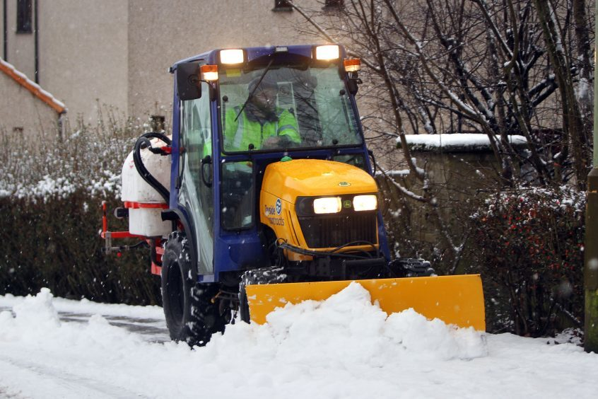 A snowplough keeping the pavements around Milnathort clear.