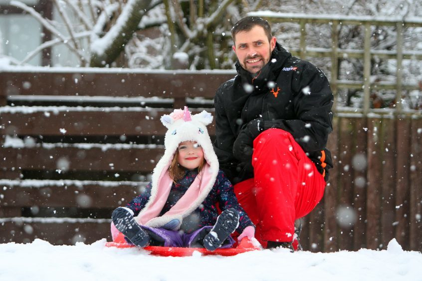 Guy and Faye Little sledging.
