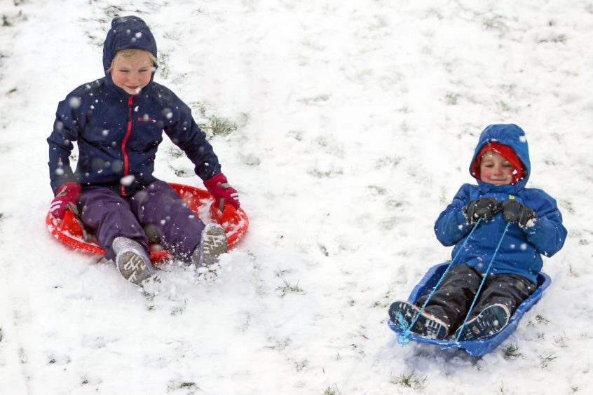 Lily and Jacob Halliday sledging in Kinross.