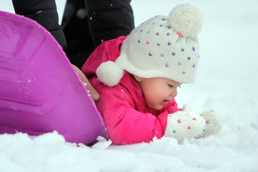 18-month-old Hannah Bradford who was experiencing snow for the first time in Kinross.