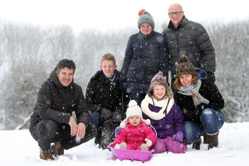 The Bradford and MacLennan families enjoying the snow in Kinross.