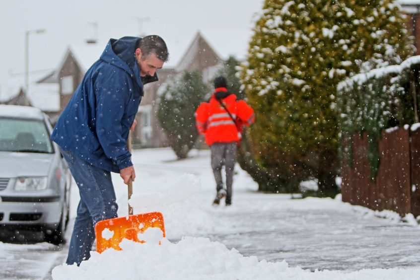 Residents clearing the streets in Kinross