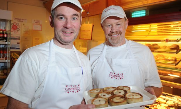 Iain Campbell and Bruce Hall with some of the scotch pies that he has learnt to make ath the King Street bakery, Crieff