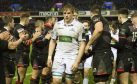 A dejected Jonny Gray walks through the ecstatic Edinburgh line-up after the first leg of the 1872 Cup.