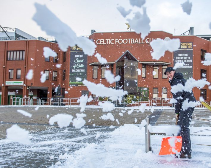 Snow is cleared of the surrounding area of Celtic Park
