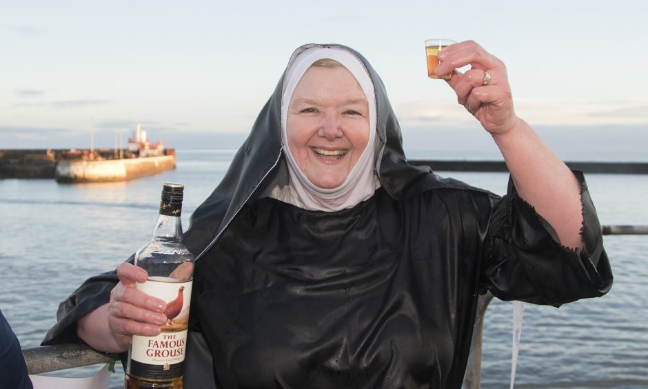 Sandra Michie from Carnoustie enjoys a warming dram after her swim