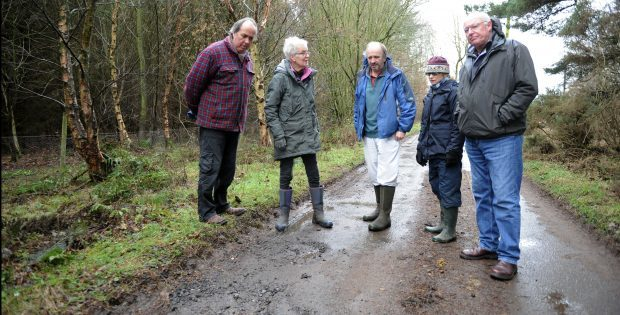 Councillor Miklinski, left, and local residents examine the state of the road at Blebo Craigs