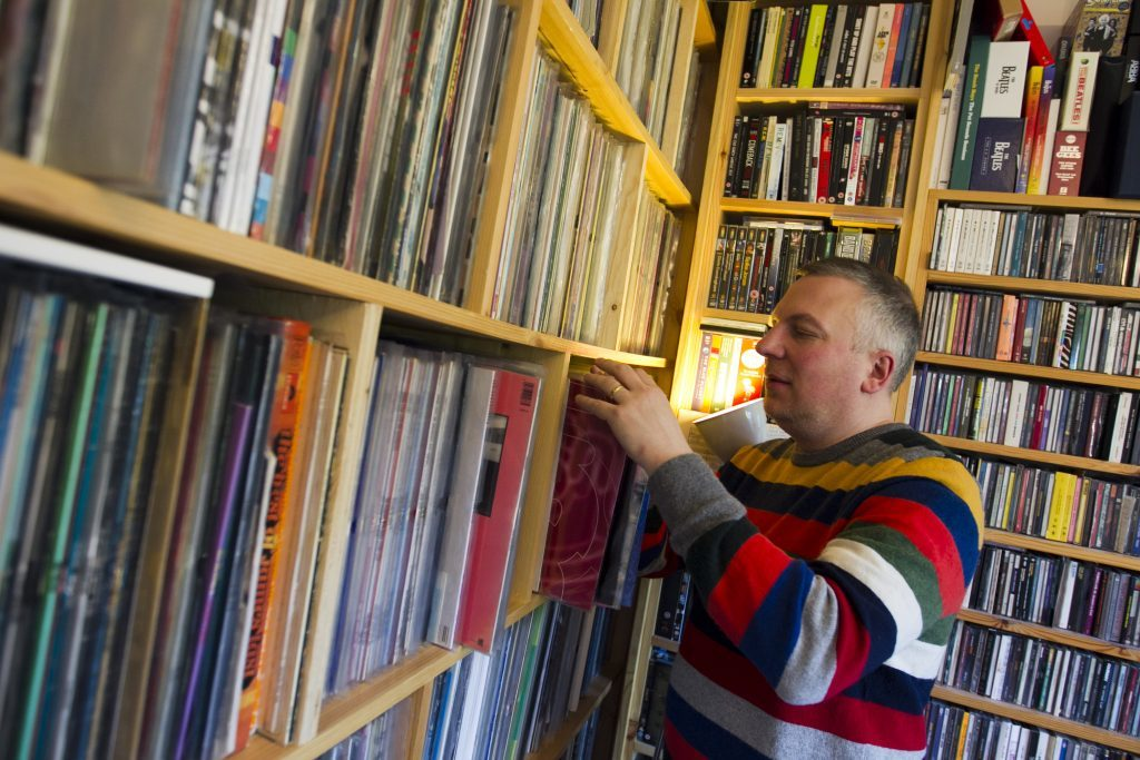 Jan Burnett browses his 12,500 strong music collection at home in Glasgow